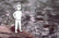 Tiny Man Standing on a Rock by the River